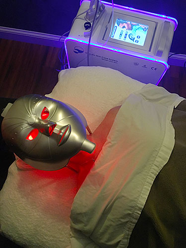 Oxy facial machine and mask on client.