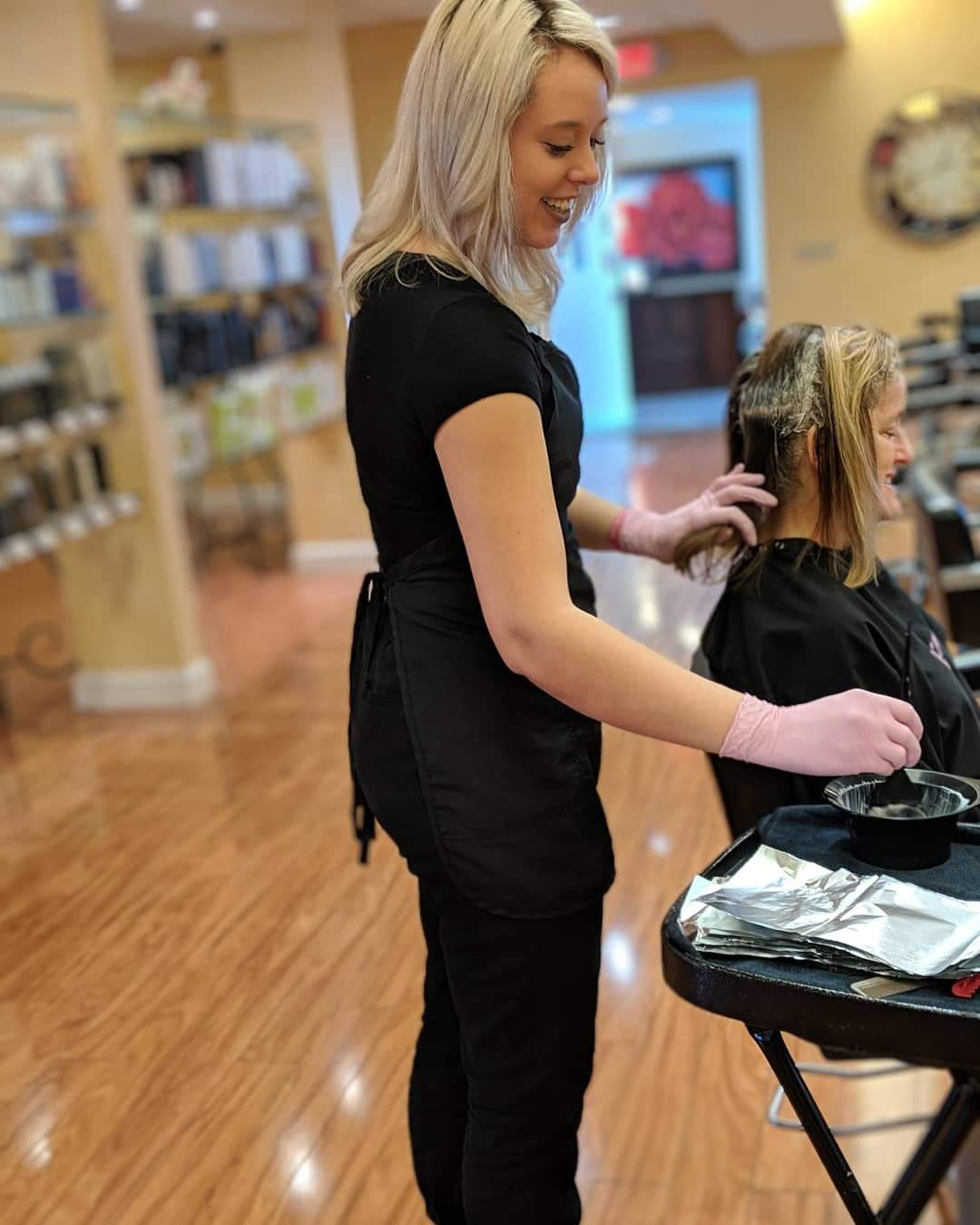Luxe Salon Hair provider doing hair treatment on client in Rochester New York
